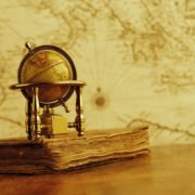Small globe sitting on a book