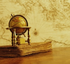 Globe and vintage book - Do you know school speed limits or cell phone laws? Do your employees know?