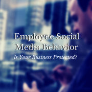 Person looking at their device - Employee Social Media Behavior, is your business protected?
