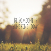 A park with grass and the sun peaking over the trees with title - Be Someones Sunshine Today