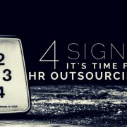 A dark room with a clock and title - 4 signs it's time for HR outsourcing