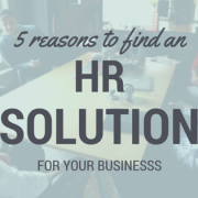 Five guys sitting around a conference table smiling at each other. Title - 5 reasons to find an HR SOLUTION for your businesss