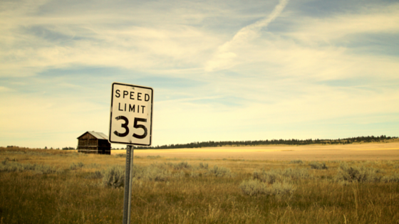 Speed limit sign, out in a prairie. Speed limit sign reads 35.
