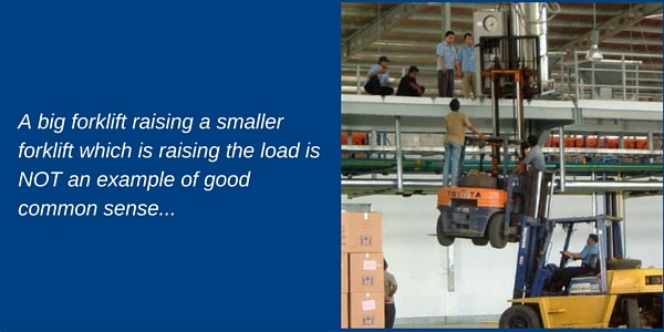 A big forklift raising a smaller forklift which is raising the load in NOT an example of good common sense...