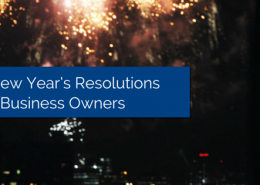 Fireworks in the night sky with tall buildings in the background and title - 4 New Year's Resolutions for Business Owners
