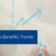 Hand drawing a graph going up with arrow on whiteboard with title - employee benefits trends