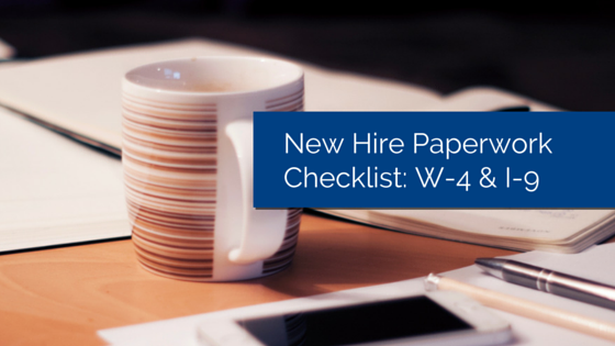 Coffee mug on table with smartphone and stack of papers with title - new hire paperwork checklist w4 i9