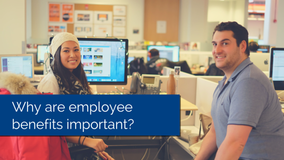 Two employees sitting at their desk, smiling and looking at the camera with title - why are employee benefits important