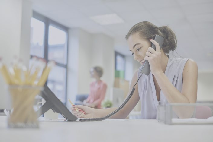 Woman on the phone with a smile on her face.