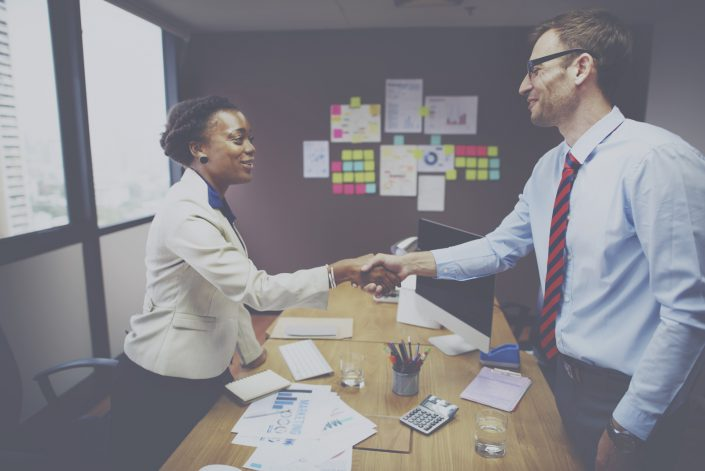 Two business people shaking hands, possibly due to a deal