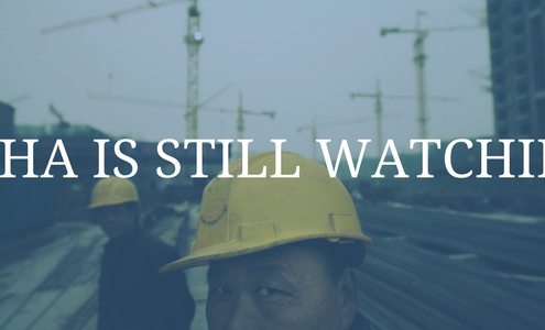 "image of two constructions workers. One is looking straight into the photo. Text over image says, ""OSHA is still watching."""